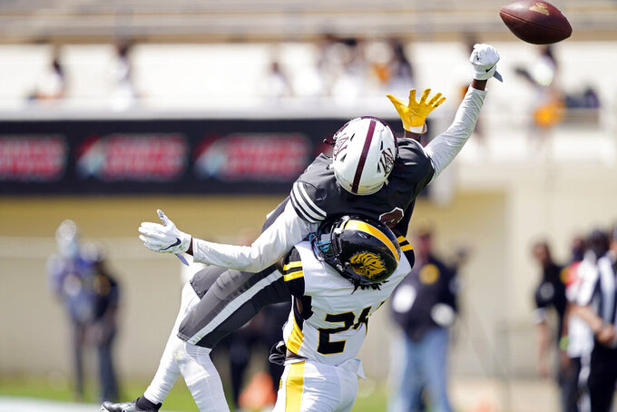 Arkansas-Pine defensive back Keyvien Johnson (24) breaks up a pass to Alabama A&M wide receiver Zabrian Moore (8) during the first half of the Southwestern Athletic Conference NCAA college football game, Saturday, May 1, 2021, in Jackson, Miss. (AP Photo/Rogelio V. Solis)