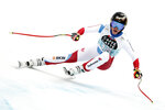 Switzerland's Lara Gut-Behrami speeds down the course during an alpine ski, women's World Cup downhill, in Crans Montana, Switzerland, Saturday, Jan. 23, 2021.(AP Photo/Gabriele Facciotti)