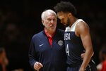 USA's head coach Gregg Popovich, left, talks with player Derrick White during their exhibition basketball game in Sydney, Australia, Monday, Aug. 26, 2019. (AP Photo/Rick Rycroft)
