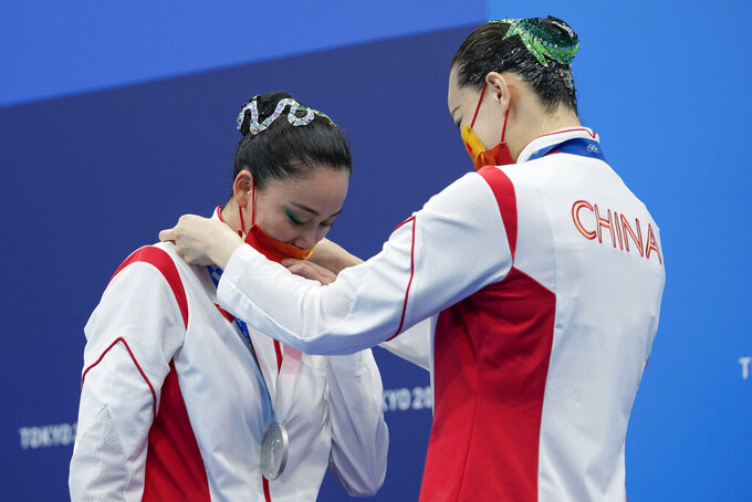 Second placed Huang Xuechen and Sun Wenyan of China wear their medals during the podium of the duet free routine final at the the 2020 Summer Olympics, Wednesday, Aug. 4, 2021, in Tokyo, Japan. (AP Photo/Alessandra Tarantino)