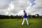 New York Mets manager Mickey Callaway walks on the field during spring training baseball practice Tuesday, Feb. 13, 2018, in Port St. Lucie, Fla. (AP Photo/Jeff Roberson)