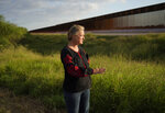 Marianna Trevino Wright, executive director of the National Butterfly Center, talks about the issues and challenges that will be caused to wildlife by new border wall being built in Mission, Texas, Monday, Nov. 16, 2020. Biden will inherit a massive wall-building effort that accelerated in Trump's final year. Almost all of the construction under Trump has taken place in wildlife refuges and Indigenous territory that already belongs to the U.S. government. (AP Photo/Eric Gay)