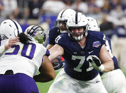 FILE - In this Saturday, Dec. 30, 2017, file photo, Penn State offensive lineman Will Fries (71) plays against Washington during the Fiesta Bowl NCAA college football game, in Glendale, Ariz. These times amid the coronavirus pandemic have brought an extra level of anxiety for current college players hoping for a stellar season or at least one that will raise their profile with NFL scouts. (AP Photo/Rick Scuteri, File)
