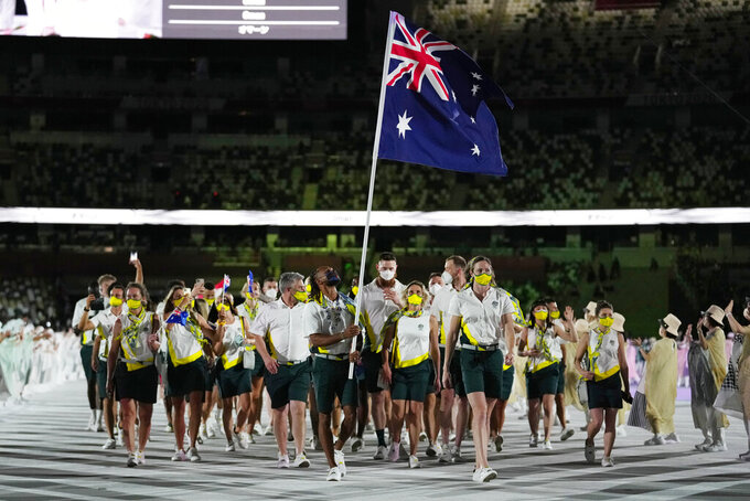 Cate Campbell and Patty Mills, of Australia, carry their country's flag during the opening ceremony in the Olympic Stadium at the 2020 Summer Olympics, Friday, July 23, 2021, in Tokyo, Japan. (AP Photo/Petr David Josek)