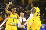 Arizona State's Remy Martin (1) and Romello White (23) celebrate during the first half of the team's NCAA college basketball game against UCLA on Thursday, Feb. 6, 2020, in Tempe, Ariz. (AP Photo/Darryl Webb)