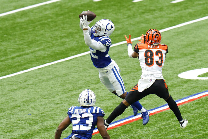 Indianapolis Colts' Julian Blackmon (32) intercepts a pass intended for Cincinnati Bengals' Tyler Boyd (83) during the second half of an NFL football game, Sunday, Oct. 18, 2020, in Indianapolis. (AP Photo/AJ Mast)