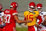 Kansas City Chiefs quarterback Patrick Mahomes (15) and tight end Travis Kelce (87) talk during an NFL football training camp Saturday, Aug. 15, 2020, in Kansas City, Mo. (AP Photo/Charlie Riedel)