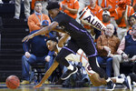 Auburn guard Jamal Johnson (1) and Furman forward Noah Gurley (4) vie for a rebound during the first half of an NCAA college basketball game Thursday, Dec. 5, 2019, in Auburn, Ala. (AP Photo/Julie Bennett)