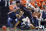 Auburn guard Jamal Johnson (1) and Furman forward Noah Gurley (4) vie for a rebound during the first half of an NCAA college basketball game Thursday, Dec. 5, 2019, in Auburn, Ala. (AP Photo/Julie Bennett)