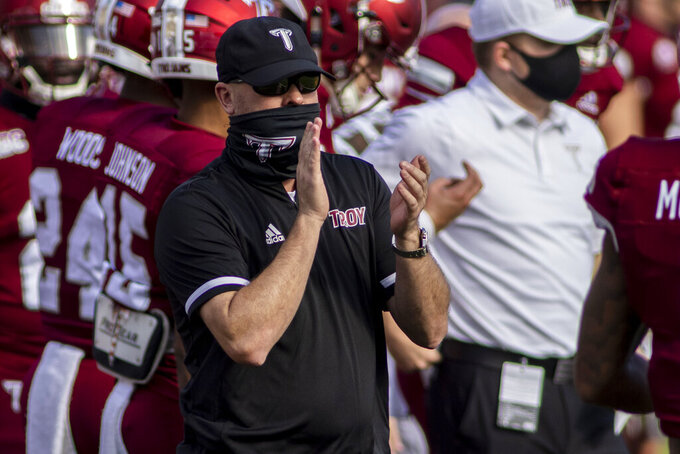 Troy head coach Chip Lindsey cheers his team against Coastal Carolina before an NCAA college football game, Saturday, Dec. 12, 2020, in Troy, Ala. (AP Photo/Vasha Hunt)