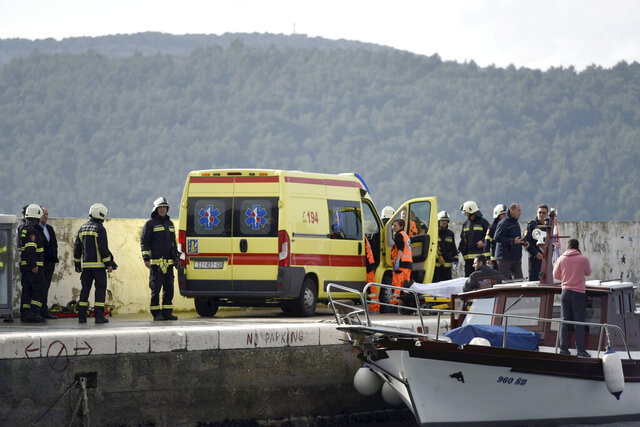The body is transferred from a boat to an ambulance during a search and rescue operation near Sibenik, Croatia, Monday, Jan. 27, 2020. A Croatian army helicopter on Monday plunged into the Adriatic Sea killing one crew member while the search is underway for the other, the country's defense minister said. (Nikolina Vukovic Stipanicev/Cropix via AP)