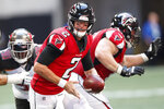 FILE - In this Sunday, Oct. 14, 2018 file photo, Atlanta Falcons quarterback Matt Ryan (2) works against the Tampa Bay Buccaneers during the second half of an NFL football game in Atlanta. The NFL's six highest-paid quarterbacks in 2018 will be spectators this postseason. Green Bay's Aaron Rodgers ($33.5 million), Atlanta's Matt Ryan ($30 million), Minnesota's Kirk Cousins ($28 million), San Francisco's Jimmy Garoppolo ($27.5 million), Detroit's Matthew Stafford ($27 million) and Oakland's Derek Carr ($25 million) couldn't lead their teams to the playoffs.  (AP Photo/John Bazemore, File)