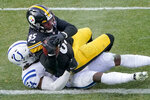 Pittsburgh Steelers tight end Eric Ebron (85) runs over Indianapolis Colts middle linebacker Anthony Walker (54) after making a catch and taking the ball in for a touchdown during the second half of an NFL football game, Sunday, Dec. 27, 2020, in Pittsburgh. (AP Photo/Gene J. Puskar)