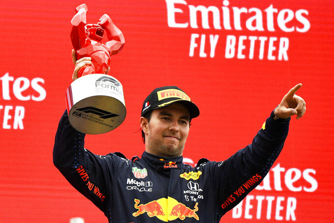 Red Bull driver Sergio Perez of Mexico celebrates from the podium his third place after the French Formula One Grand Prix at the Paul Ricard racetrack in Le Castellet, southern France, Sunday, June 20, 2021. (Nicolas Tucat/Pool via AP)