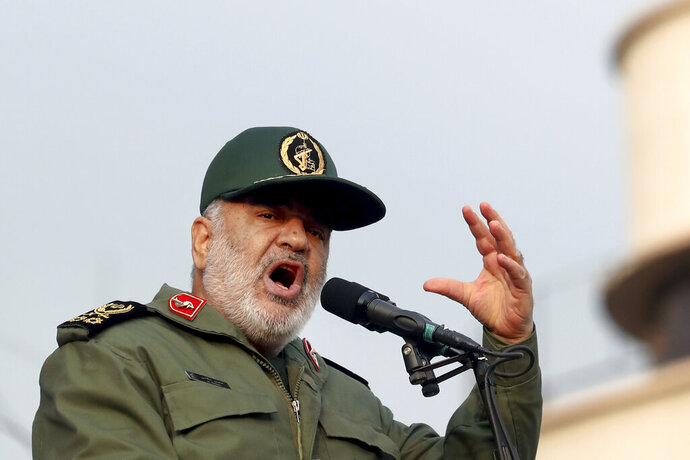 """FILE - In this Monday, Nov. 25, 2019 file photo, Chief of Iran's Revolutionary Guard Gen. Hossein Salami speaks at a pro-government rally, in Tehran, Iran. The chief of Iran's paramilitary Revolutionary Guard has threatened to go after everyone who had a role in a top general's January killing during a U.S. drone strike in Iraq. The guard's website on Saturday, Sept. 19, 2020 quoted Gen. Hossein Salami as saying, """"Mr. Trump! Our revenge for martyrdom of our great general is obvious, serious and real."""" U.S. President Donald Trump warned this week that Washington would harshly respond to any Iranian attempts to take revenge for the death of Gen. Qassem Soleimani.  (AP Photo/Ebrahim Noroozi, File)"""