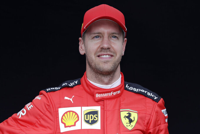 In this picture taken March 12, 2020 Ferrari driver Sebastian Vettel of Germany poses for a photo at the Australian Formula One Grand Prix in Melbourne. Four-time Formula One champion Sebastian Vettel will leave Ferrari at the end of the year, the Italian team said Tuesday, May 12, 2020. Ferrari said the decision was by mutual consent. (AP Photo/Rick Rycroft)