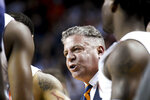 Auburn coach Bruce Pearl talks with guard J'Von McCormick during the first half of the team's NCAA college basketball game against Vanderbilt on Wednesday, Jan. 8, 2020, in Auburn, Ala. (AP Photo/Julie Bennett)