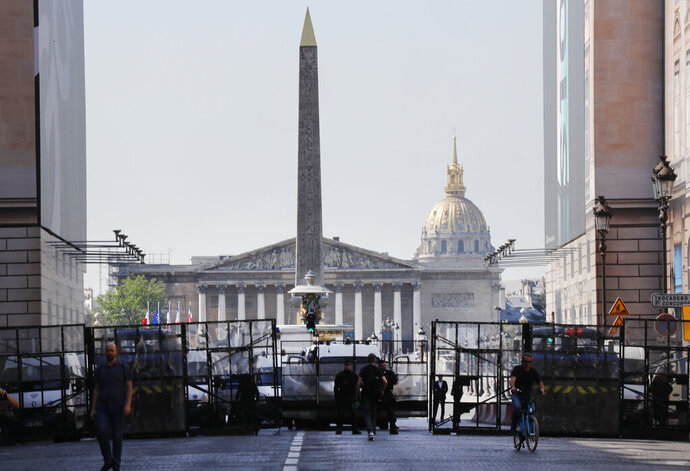 Police seal off an area around the Place de la Concorde prior to a yellow vest demonstration in Paris, Saturday, April 20, 2019. French yellow vest protesters are marching anew to remind the government that rebuilding the fire-ravaged Notre Dame Cathedral isn't the only problem the nation needs to solve. (AP Photo/Michel Euler)
