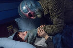 This image released by SYFY shows Judah Prehn, left, and Alien Harry in the new series