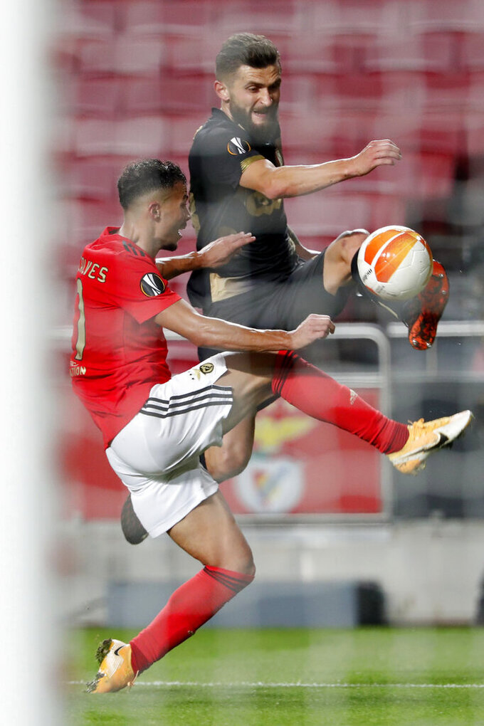 Liege's Nicolas Gavory tries to get a shot past Benfica's Diogo Goncalves, left, during the end of the Europa League group D soccer match between Benfica and Standard Liege at the Luz stadium in Lisbon, Thursday, Oct. 29, 2020. Benfica won 3-0. (AP Photo/Armando Franca)