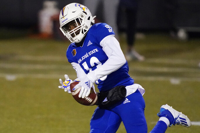 San Jose State wide receiver Jermaine Braddock catches a pass before running in for a touchdown against Nevada during the first half of an NCAA college football game Friday, Dec. 11, 2020, in Las Vegas. (AP Photo/John Locher)