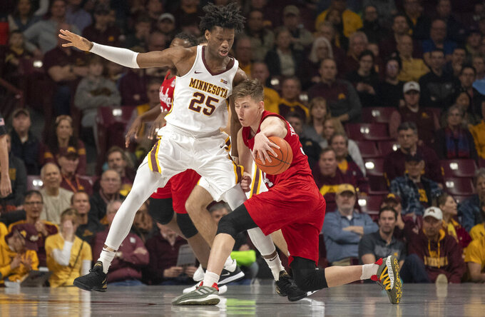 Minnesota center Daniel Oturu (25) defends against Nebraska guard Thorir Thorbjarnarson (34) in the first half of an NCAA college basketball game Sunday, March 8, 2020, in Minneapolis. (Jerry Holt/Star Tribune via AP)
