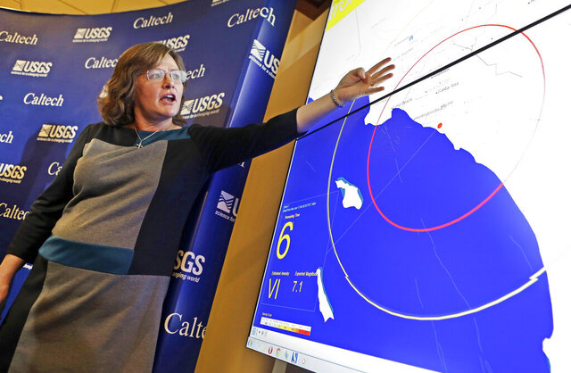 FILE - This Jan. 28, 2013 file photo seismologist, Dr. Lucy Jones, describes how an early warning system would provide advance warning of an earthquake, at a news conference at the California Institute of Technology in Pasadena, Calif. California's earthquake early warnings will be a standard feature on all Android phones, bypassing the need for users to download the state's MyShake app in order to receive alerts, the Governor's Office of Emergency Services said. The state worked with the U.S. Geological Survey and Google, the maker of Android, to build the quake alerts into all phones that run the commonplace operating system. The deal was expected to be announced Tuesday, Aug. 11, 2020. (AP Photo/Reed Saxon, File)