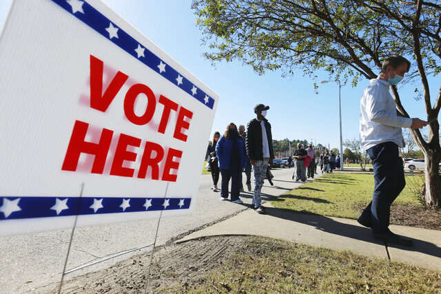 Voters slowly make their way through the long line at the J.T. Neely Building at Veterans Park in Tupelo Miss., Tuesday, Nov. 3, 2020, as they and others vote for the next president.(Thomas Wells/The Northeast Mississippi Daily Journal via AP)
