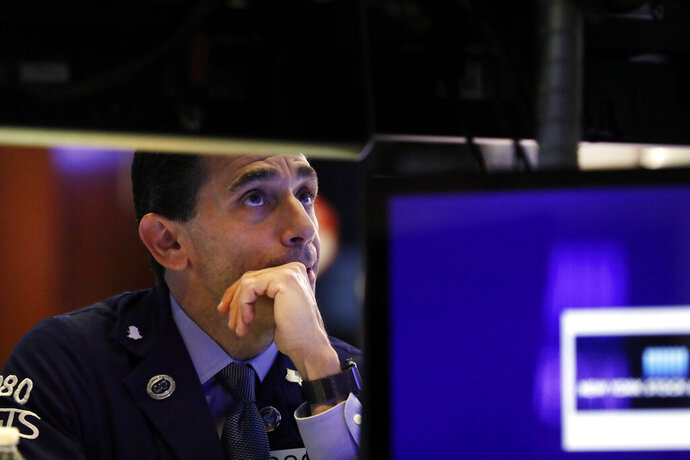 FILE - In this Oct. 2, 2019, file photo specialist Peter Mazza works on the floor of the New York Stock Exchange. The U.S. stock market opens at 9:30 a.m. EDT on Wednesday, Oct. 23. (AP Photo/Richard Drew, File)