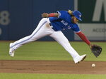 Toronto Blue Jays' Vladimir Guerrero Jr. makes a play during second-inning baseball game action against the Seattle Mariners in Toronto, Saturday, Aug. 17, 2019. (Fred Thornhill/The Canadian Press via AP)