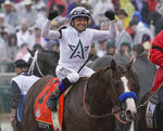 Mike Smith celebrates after riding Justify to victory during the 144th running of the Kentucky Derby horse race at Churchill Downs Saturday, May 5, 2018, in Louisville, Ky. (AP Photo/Morry Gash)