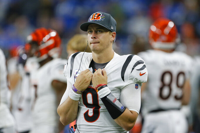 Cincinnati Bengals quarterback Joe Burrow stands on the sideline during the second half of an NFL football game against the Detroit Lions, Sunday, Oct. 17, 2021, in Detroit. (AP Photo/Duane Burleson)