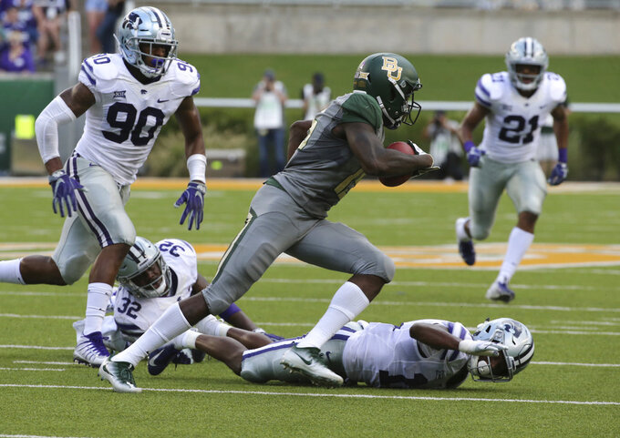 Baylor wide receiver Denzel Mims, center, runs past Kansas State AJ Parker, right, Justin Hughes, and Bronson Massie, left, during the first half of an NCAA college football game, Saturday, Oct. 6, 2018, in Waco, Texas. (Rod Aydelotte/Waco Tribune-Herald via AP)