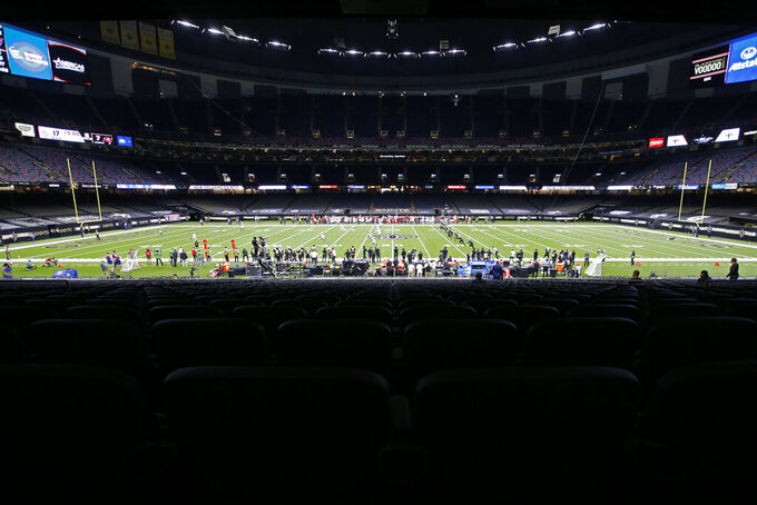 The New Orleans Saints and the Tampa Bay Buccaneers play in the Superdome without any fans, due to the COVID-19 pandemic, in the second half of an NFL football game in New Orleans, Sunday, Sept. 13, 2020. (AP Photo/Butch Dill)