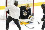 Boston Bruins goalie Max Lagace makes a save at the NHL hockey team's camp on Wednesday, July 15, 2020, in Boston. (AP Photo/Charles Krupa)
