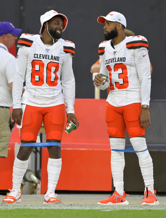 Cleveland Browns' Jarvis Landry (80) and Odell Beckham Jr. (13) talk during the first half of the team's NFL preseason football game against the Washington Redskins, Thursday, Aug. 8, 2019, in Cleveland. (AP Photo/David Richard)