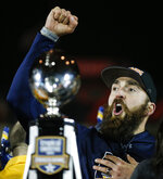 Kent State coach Sean Lewis celebrates the team's 51-41 win over Utah State in the Frisco Bowl NCAA college football game Friday, Dec. 20, 2019, in Frisco, Texas. (AP Photo/Brandon Wade)