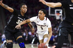 South Carolina guard Zia Cooke (1) dribbles against Vanderbilt guard Lea Lea Carter (30) during the first half of an NCAA college basketball game Monday, Feb. 17, 2020, in Columbia, S.C. (AP Photo/Sean Rayford)