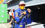 Mclaren driver Carlos Sainz of Spain walks on the pit line after clocking the third fastest time during the qualifying session for Sunday's Italian Formula One Grand Prix, at the Monza racetrack in Monza, Italy, Saturday, Sept. 5, 2020. (Jennifer Lorenzini/Pool via AP)