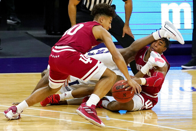 Indiana guards Rob Phinisee, left, and Armaan Franklin, right, work against Northwestern guard Chase Audige for the ball in the second overtime of an NCAA college basketball game in Evanston, Ill., Wednesday, Feb. 10, 2021. (AP Photo/Nam Y. Huh)