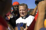 FILE - In this July 7, 2018, file photo, Rev. Michael Pfleger, pastor of the Saint Sabina Catholic church on Chicago's Southside, speaks to protesters before marching on the Dan Ryan Expressway in Chicago. In a letter written to the Saint Sabina community, Chicago Cardinal Blasé Cupich announced Tuesday, Jan. 5, 2021, he has asked Pfleger to step aside from his ministry following receipt of a sexual abuse allegation of a minor by Pfleger more than 40 years earlier. (AP Photo/Annie Rice, File)