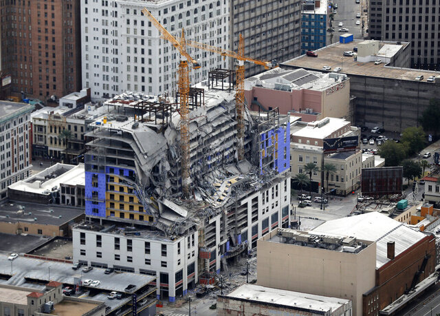 FILE - This Oct. 12, 2019, file photo, shows damage of a partial collapse at the Hard Rock Hotel under construction in New Orleans. Dozens of protesters marched from the site of the partially collapsed Hard Rock Hotel on the edge of the French Quarter to City Hall on Friday, Jan. 24, 2020 demanding that something be done about the hotel and that the two bodies still inside be recovered.  (AP Photo/Gerald Herbert, File)
