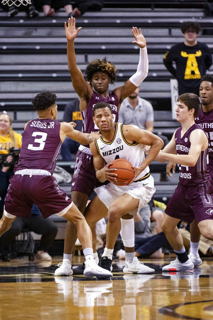 Missouri's Javon Pickett looks to pass as he is surrounded by Southern Illinois' Ronnie Suggs, left, Trent Brown, right, and Harwin Francois, back, during the first half of an NCAA college basketball game Sunday, Dec. 15, 2019, in Columbia, Mo. (AP Photo/L.G. Patterson)