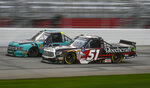 Kyle Busch (51) and Johnny Sauter run side by side during the NASCAR Truck Series auto race at Atlanta Motor Speedway, Saturday, Feb. 23, 2019, in Hampton, Ga. (AP Photo/John Amis)
