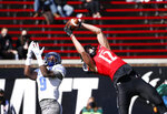Cincinnati wide receiver Alec Pierce (12) catches a touchdown pass in front of Memphis defensive back John Broussard Jr. (9) during the first half of an NCAA college football game Saturday, Oct. 31, 2020, in Cincinnati. (Photo by Gary Landers)