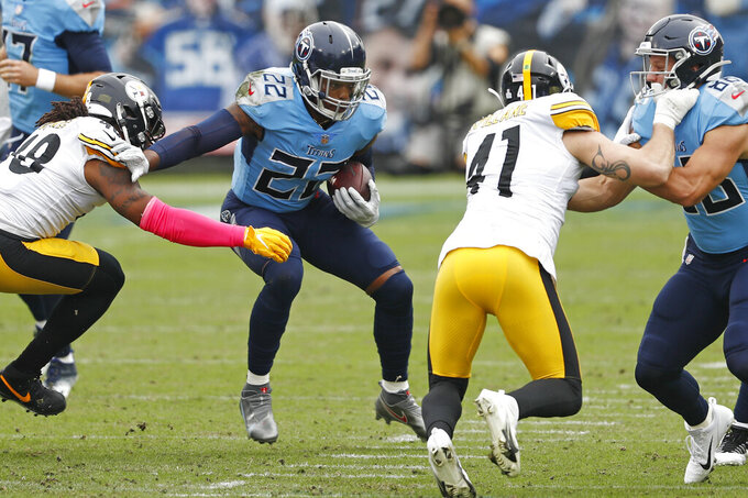 Tennessee Titans running back Derrick Henry (22) carries the ball against the Pittsburgh Steelers in the first half of an NFL football game Sunday, Oct. 25, 2020, in Nashville, Tenn. (AP Photo/Wade Payne)