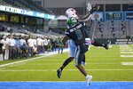 SMU wide receiver Rashee Rice (11) reaches for a touchdown pass against Tulane cornerback Jaylon Monroe (9) during an NCAA college football game in New Orleans, Friday, Oct. 16, 2020. (AP Photo/Matthew Hinton)