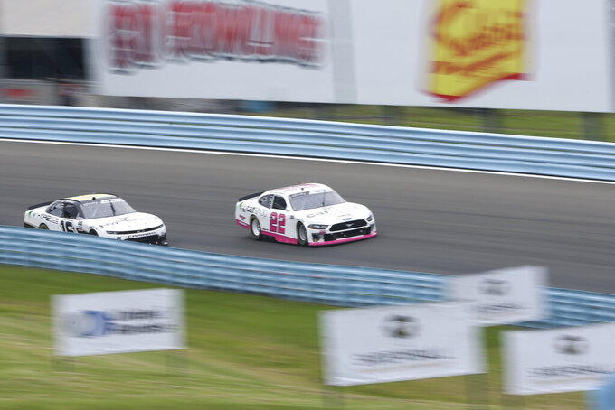 Austin Cindric (22) and AJ Allmendinger (16) turn into the esses during the first stage of a NASCAR Xfinity Series auto race at Watkins Glen International in Watkins Glen, N.Y., Saturday, Aug. 7, 2021. (AP Photo/Joshua Bessex)