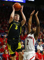 Oregon guard Payton Pritchard (3) drives past Arizona guard Brandon Williams (2) in the first half of an NCAA college basketball game, Thursday, Jan. 17, 2019, in Tucson, Ariz. (AP Photo/Rick Scuteri)