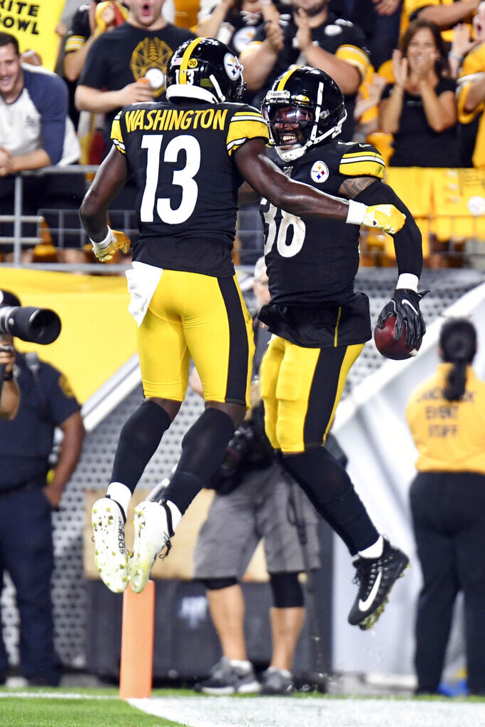 Pittsburgh Steelers running back Jaylen Samuels (38) celebrates with wide receiver James Washington (13) after making a touchdown ion the first half of a preseason NFL football game against the Kansas City Chiefs, Saturday, Aug. 17, 2019, in Pittsburgh. (AP Photo/Barry Reeger)